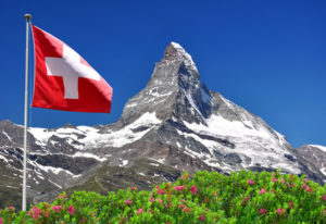Beautiful mountain Matterhorn with Swiss flag - Swiss Alps
